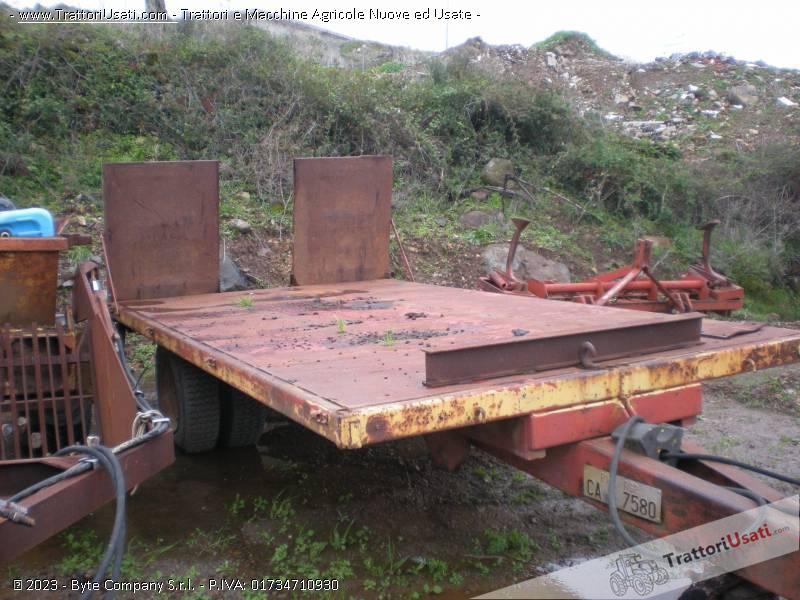 Pianale traporto cingoli menci for Trattori agricoli usati in sardegna