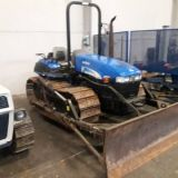 cingolato New holland tk 100 a